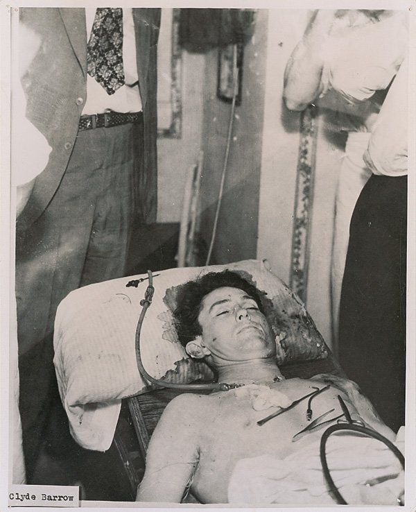 Clyde Barrow at the undertaker's after his death at the hands of law enforcement officers, with his body in the midst of the embalming process, his head resting on a blood-soaked pillow. Photo c.1950.