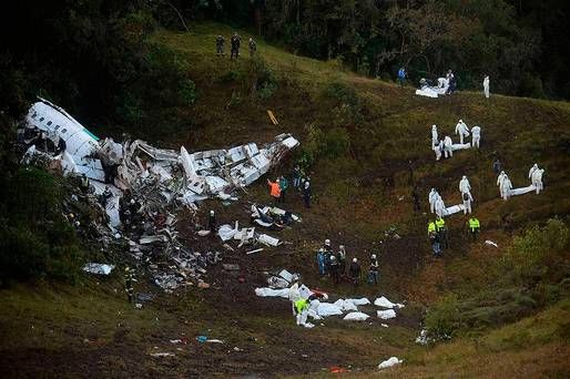 Rescuers search for survivors from the wreckage of the LAMIA airlines charter plane carrying members of the Chapecoense Real football team that crashed in the mountains of Cerro Gordo, municipality of La Union, on November 29, 2016. A charter plane carrying the Brazilian football team crashed in the mountains in Colombia late Monday, killing as many as 75 people, officials said. / AFP PHOTO / Raul ARBOLEDARAUL ARBOLEDA/AFP/Getty Images