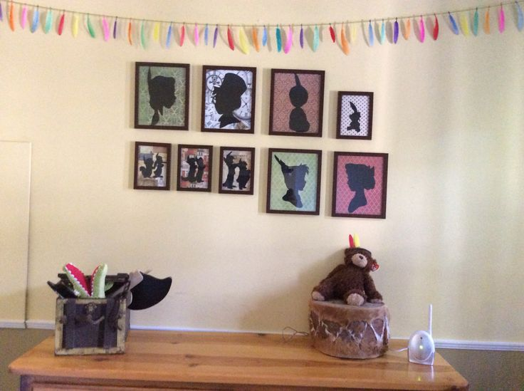 Neverland Nursery  Print silhouettes of the characters, glue onto background of choice and frame