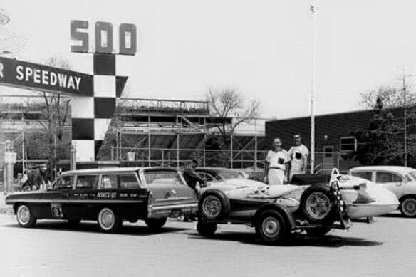 In Indy car racing in 1961, this was a classy combo: a brand-new Pontiac wagon pulling a single-axle trailer with sponsorship from Bowes Seal Fast. Driven by AJ Foyt, the Trevis-Offy (Watson copy) on the trailer won that year's Indy 500. That's crew chief George Bignotti on the left posing proudly with the top-shelf rig.