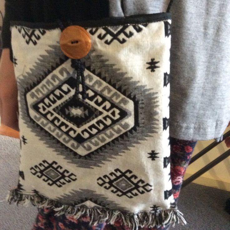 Fringed reversible bag with vintage button in contrast colour, made by 11yr old student in a half day workshop.