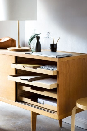 A cabinet or sideboard with shelves that slide out may make the perfect desk. Photo: Scott Hawkins, Styling: Rachel Brown #offices http://www.homelife.com.au/decorating/galleries/7+home+office+essentials,10235?pos=2