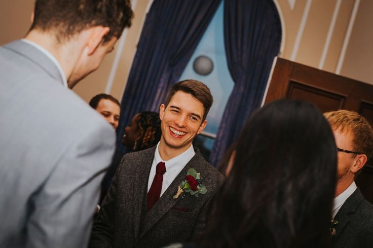 A warm woolen 3 piece suit was a must for this November wedding in Norfolk. Maroon tie and buttonhole finish it off a treat. Photo by Benjamin Stuart Photography #weddingphotography #groom #woolsuit #3piece #groomsuit #weddingday #maroon