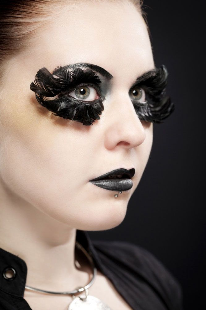 huge black feather eyelashes and gothic makeup. Using