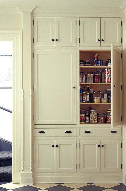 Cabinets:  Be shallow. Instead of wall cabinets, I like to install shallow floor-to-ceiling pantries. They're an efficient use of an interior wall, where you can't have a window anyway. By limiting the depth to just 6 to 9 inches, you are forced to line up your dry goods in a single row, making everything easier to find.