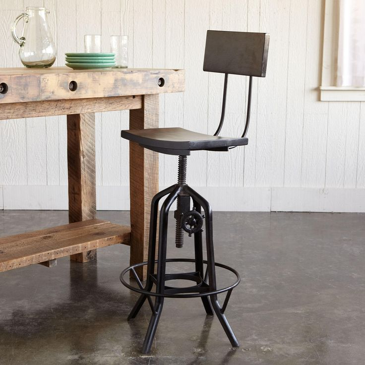 BESSEMER ADJUSTABLE STOOL   Burnt Wax Finish, The Curved Wood Backrest And  Seat, Cast Iron Base Provides A Handy Foot Rest.