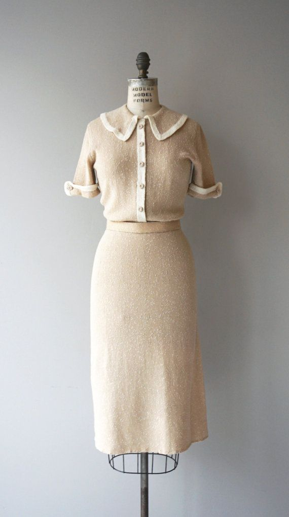 Vintage 1950s very soft boucle wool dress in light latte with cream trim, oversized collar, short sleeves, false button front and matching belt. --- M
