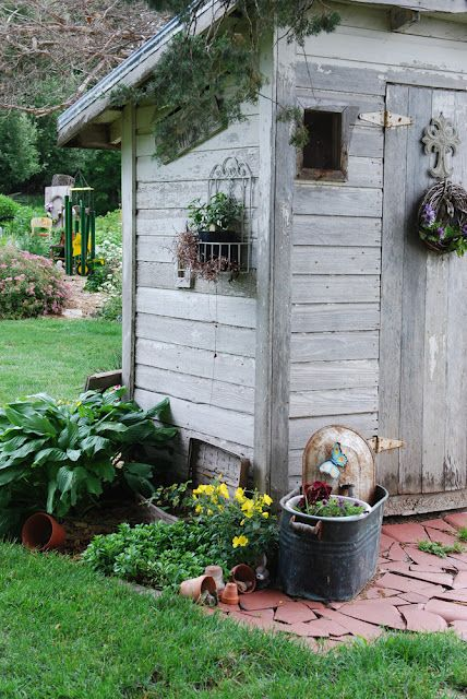 I like the colour of the tiles around the little wooden shed, potted flowers :))