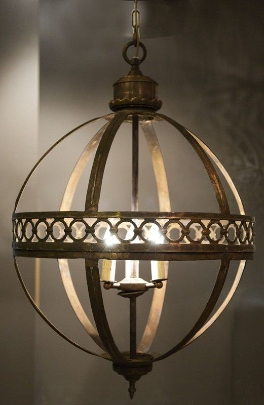 The Amalfi Lantern is a stunning spherical lantern with a beautifully ornate antique bronze finish.  Dimensions:  Small Diameter:  43cm (ELD16)  Large Diameter: 60cm (ELD15)     Pendant features an antique bronze metal decorative frame with glass panels  Includes ceiling plate and 100cm of chain  Takes 3 x E27 globes