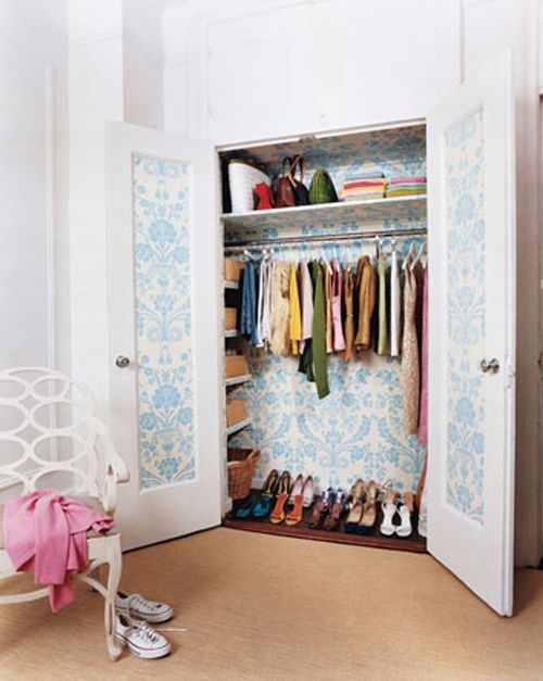 love this closet {it's cute how they used wallpaper on the doors and the interior of the closet}