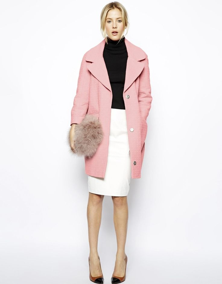 We saw oversized pink coats all over Lincoln Center this season, and judging by the runway, this trend isn't going anywhere in the near future. Wear it now and tuck it away for next season! via @stylelist