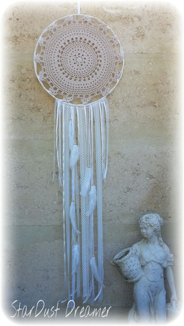Angelic Dreams  Extra Large Dreamcatcher!! This big beauty is perfect for any room!! With a large Beige Doily and meters and meters of lace ribbon and wool this is a breath taking impact piece!! Natural wooden beads and fluffy white feathers finish off this beautiful dreamer. http://stardustdreamer.com.au/shop/dreamcatchers/angelic-dreams/