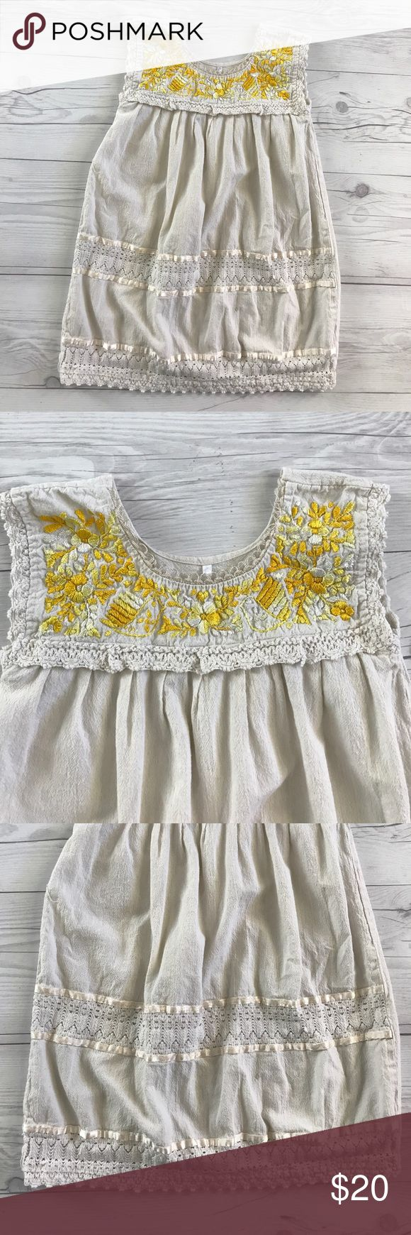 Bohemian style dress Cream color dress with yellow flower embroidery and crochet details. Like new condition size 6. I have lots of children's clothing check out my closet. ALL ITEMS ARE BUY 3 GET 1 FREE! Dresses