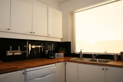 How to Use Wall Molding to Reface Kitchen Cabinets thumbnail: Kitchens, Painting Laminate, Ehow, How To Paint, Kitchen Ideas, Dishwasher, Kitchen Cabinets