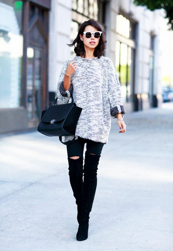 A cozy over-sized sweater with torn black skinny jeans