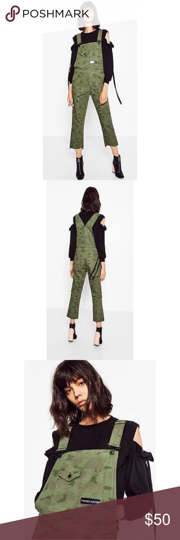 """Zara Cropped Camouflage Jumper Only Worn Once Camo Jumper. You can style it with  sneakers or wear a bootie with it since it cropped. It has a plate on the from saying """"Trends Hunter"""". A more causal light  Camo Print compare to your regular prints. Zara Pants Jumpsuits & Rompers"""