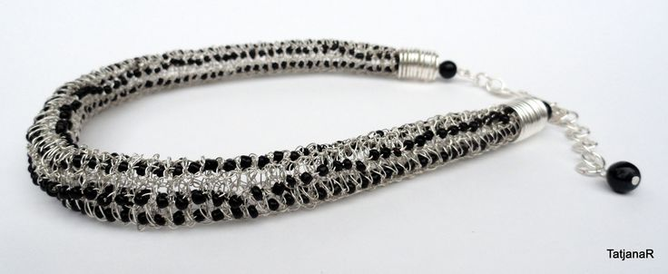Necklace crochet with silver pleated cooper wire and black glass beads.