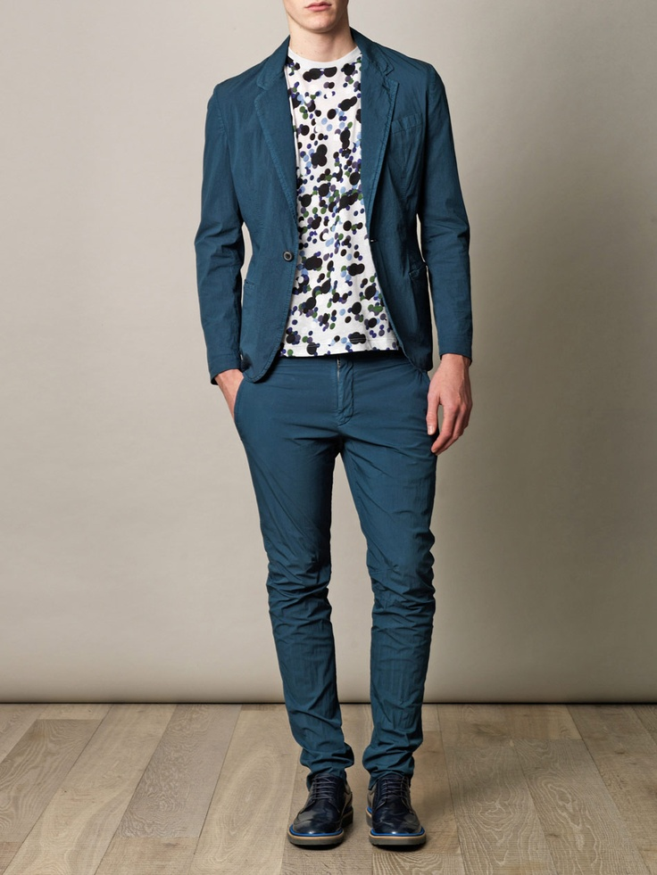 High-shine navy brogues with long-wing detailing and contrasting blue trim and grey rubber sole. You can tell a lot about a man from his shoes. Paul Smith lets you say all the right things with this eclectic pair; taking all the raffish, tongue-in-cheek charm of the British fashion legend to a new level.    Shown here with Lanvin Biker chino trousers, Lanvin Lightweight cotton jacket and Lanvin Spot-print T-shirt.