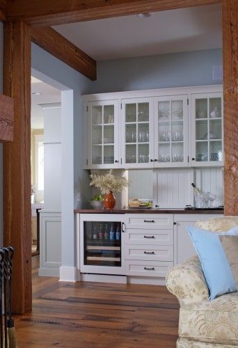 FINALLY! first picture I've found with a white surround wine/ beverage cooler built in. THIS is what I want!