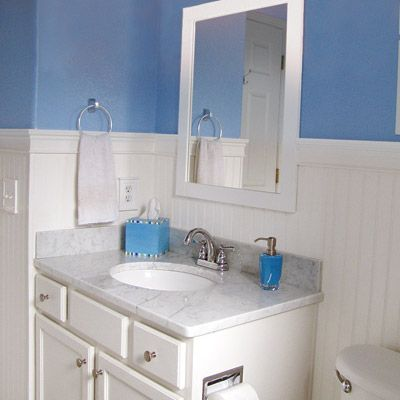Bathroom renovation on a budget $325.00 retiled the floor with a white mosaic. For moral support and construction advice, Jessica called her dad as often as three times a day. The tiling went well, but while removing the new marble top to add the wainscoting, the stone cracked.