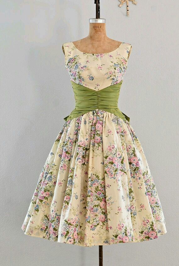 The solid colored cinched waist on this dress makes for an interesting look next to the floral design.