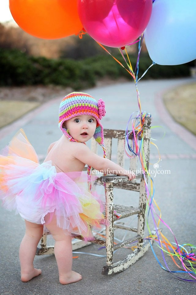 Rainbow Tuiti Fruity crochet earflap flower stripe hat tutu set perfect for newborn or baby girl first birthday photography prop pictures. $48.00, via Etsy.