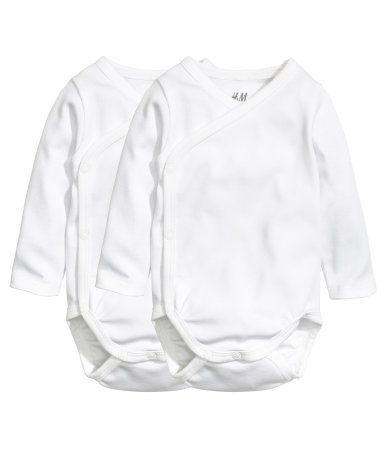 White. CONSCIOUS. Wrap-front bodysuits in soft, organic cotton jersey with long sleeves. Snap fasteners at side and gusset.