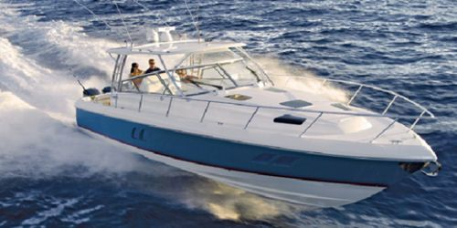 Intrepid 475 Sport Yacht: Life is good when you are flying low in an Intrepid 475 Sport Yacht. Too bad everyone can't have one.