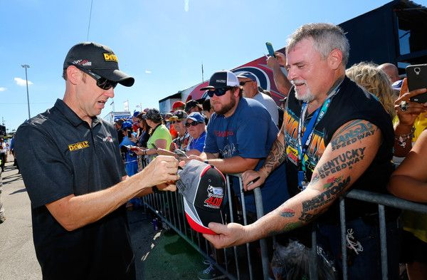 Matt Kenseth, driver of the #20 DeWalt Hurricane Relief Toyota, signs autographs prior to the driver's meeting for the Monster Energy NASCAR Cup Series Championship Ford EcoBoost 400 at Homestead-Miami Speedway on November 19, 2017 in Homestead, Florida.