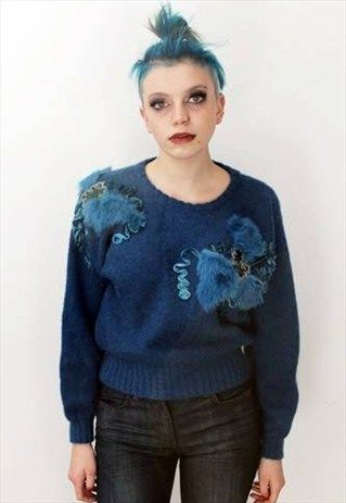 Vintage 80's Blue Slouchy alternative Jumper // This is a unique vintage, hand picked item by Pretty Disturbia which is right on trend!  FABRIC -80% Acrylic 20% Nylon It really is stunning and unusual. - it is perfect for any occasion!  DETAILS- It is high quality and unusual. It is classic and has gold fake fur trim with embellishment.. will have been very expensive new! STYLING- This is perfect for a night out with heels and skinny jeans or in the day with boots and a denim jacket, it goes…
