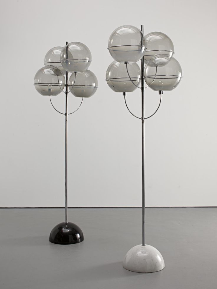 VICO MAGISTRETTI Pair of 'Colleoni' standard lamps, c. 1971 Tubular chrome-plated metal, smoked glass, marble. Each: 256 cm (100 3/4 in) high Manufactured by Knoll International, Italy. Each glass shade with glass seal 'COLLEONI LAMP·VENICE 1971'
