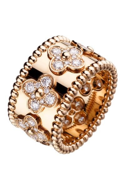 A fantastic gold and diamond floral motif,  wedding band. I rather have this ring to wear daily... than a solitaire.   (The Jewelry of Van Cleef & Arpels | Smithsonian)