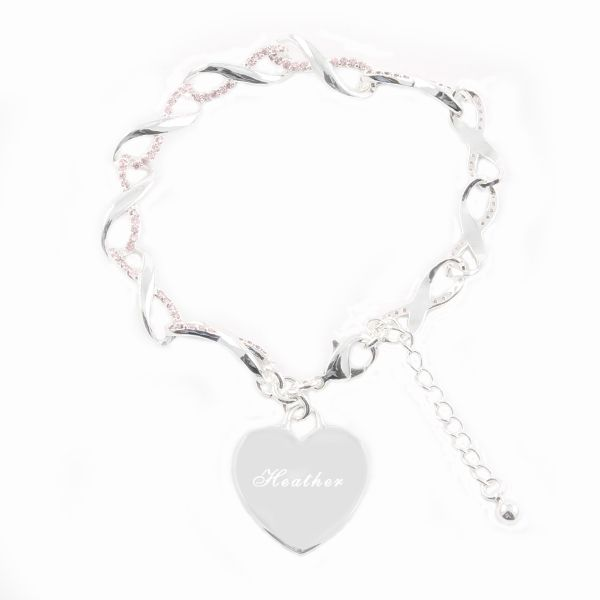 Twirly Infinity Chain Bracelet with Heart Charm - The chain is made up of infinity symbols all linked together and adorned with tiny pink crystals. A heart charm is attached which is a perfect spot for engraving her name or a short message.