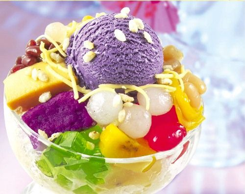 Halo-halo (Filipino Shaved Ice Milk Dessert with Assorted Tropical Preserved Fruits, Jellies, Leche Flan and Ube Jam.
