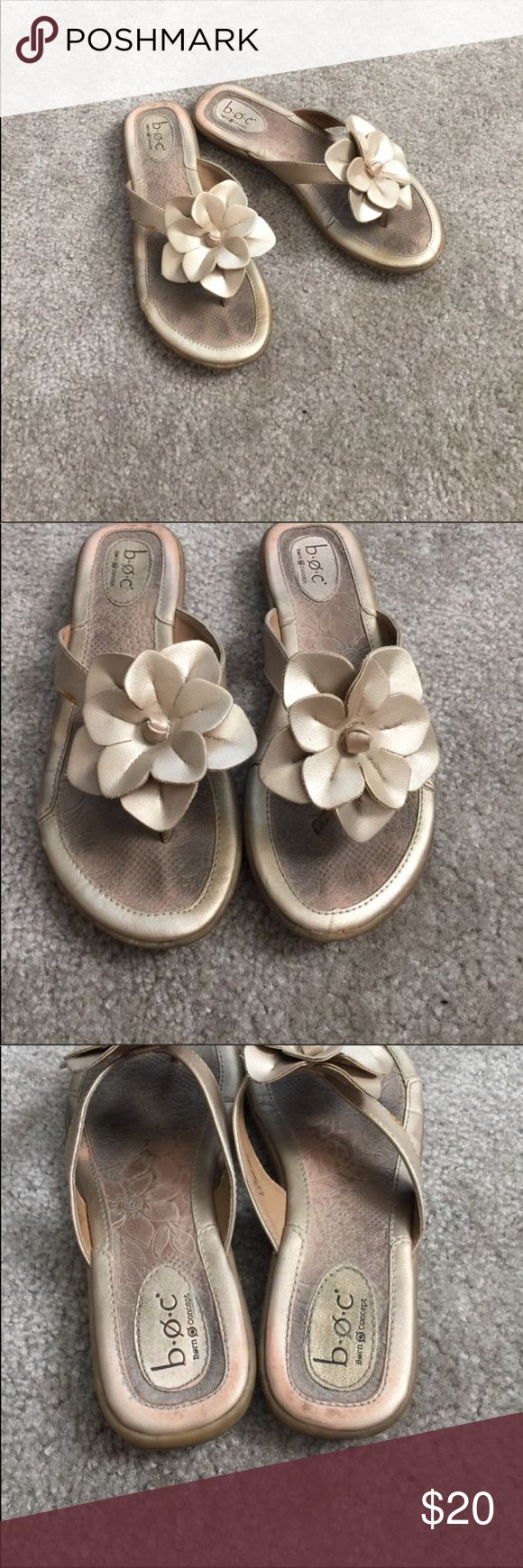 Born B.O.C. Gold flip flop sandals with flower Good used condition sandals from Born B.O.C. Signs of wear shown, not noticeable when wearing. Still have lot of life left! b.o.c. Shoes Sandals