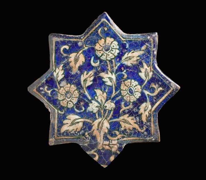 Tile | Origin: Greater Iran | Period:  mid-15th century | Collection: The Madina Collection of Islamic Art, gift of Camilla Chandler Frost (M.2002.1.260) | Type: Ceramic; Architectural element, Fritware, molded and underglaze-painted, Point to point: 8 3/8 in. (21.27 cm)