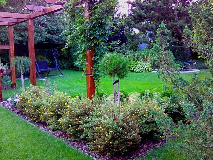 Ogród przydomowy. Kącik wypoczynkowy w ogrodzie.Rabaty w ogrodzie. Ogrody Kielce. Projektowanie ogrodów Kielce.