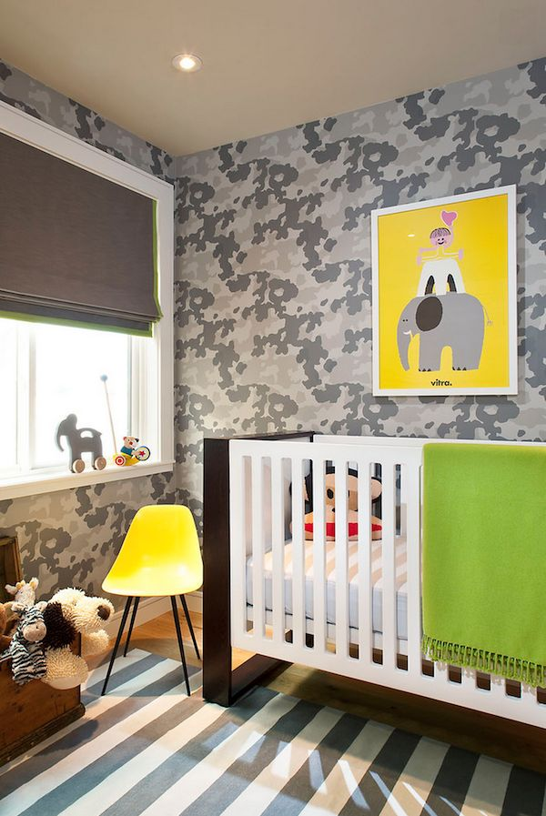 Modern #baby nursery with #camouflage graphic #wallpaper, roman shades, and striped #rug.