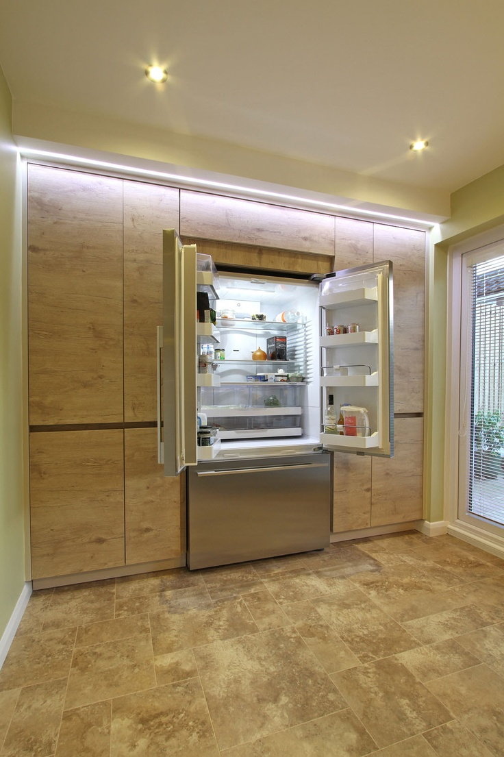 Rotpunkt Cubica High Gloss Kitchen in Sand: One of the great features of this kitchen is the perfectly integrated full height storage. We got the plasterers to box the top of the unit and around the edges to really give a completely integrated look. We think the LED light really finish it off.