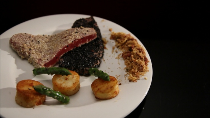Sesame encrusted Tuna with Pan Fried Potato, Ginger Garlic Aioli, Asparagus & Jamón Crumbs