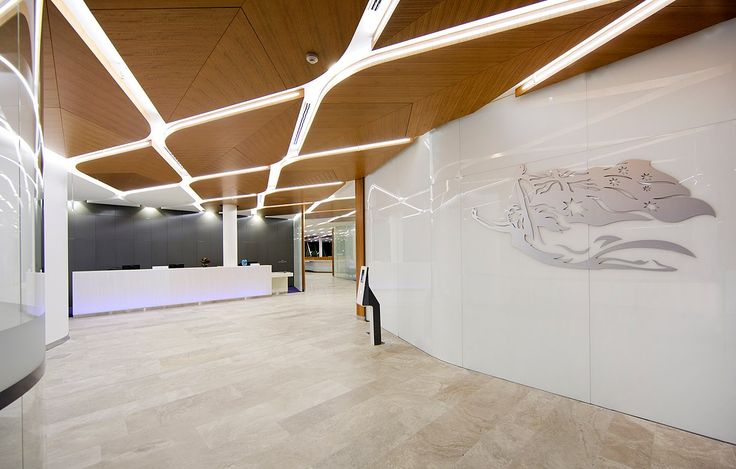 TZG Archtiects Virgin lounge Canberra  Key Lena with specified timber veneer  custom shaped and perforated ceiling panels