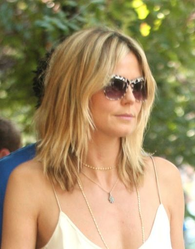 Heidi Klums casual shag  my hair looks alot like this right now! Cant wait for it to get longer!