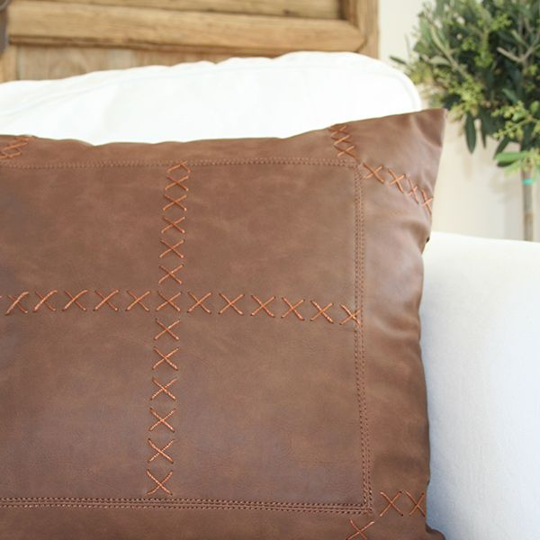 This leather pillow, southwestern pillow has a warm rustic colour and a decorative criss cross embroidery. A great accessory for your sofa.