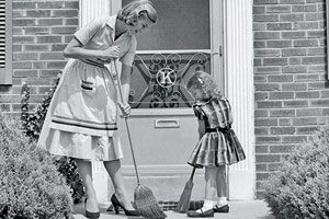 little girl and mother sweeping the stoop in black and white