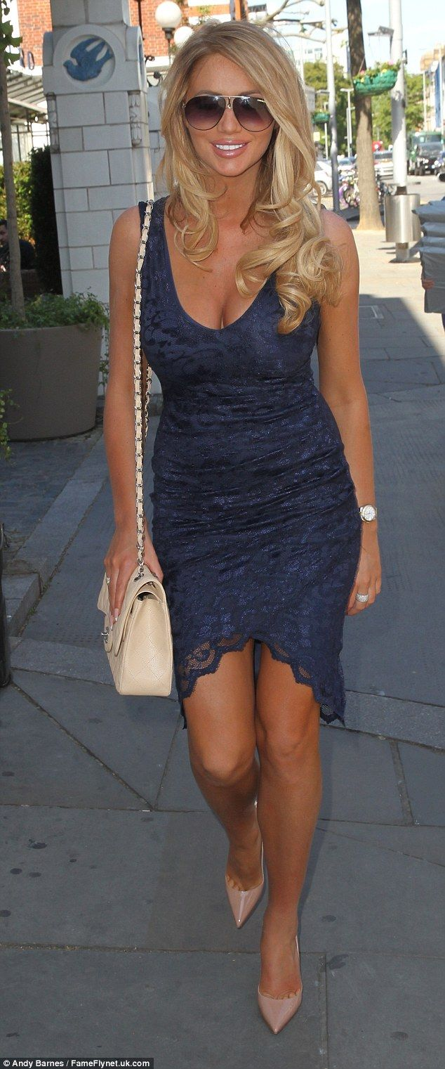 Blonde bombshell: Amy Childs showed off her new lighter locks as she headed out in London on Thursday