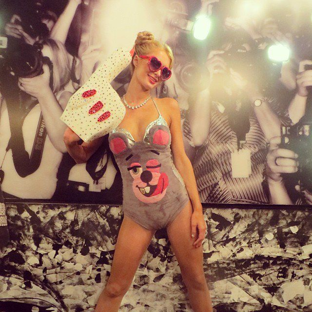 Pin for Later: Look Back at the Best Celebrity Halloween Candids  Paris Hilton did her best Miley Cyrus impression for Halloween, foam finger and all. Source: Instagram user parishilton