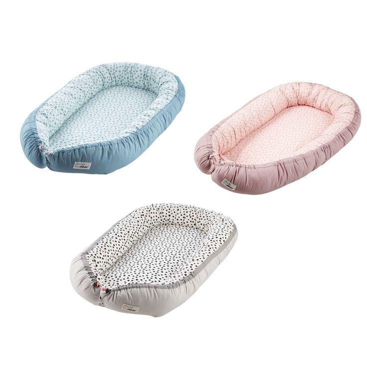 Done by Deer Cozy Nest Happy dots - ein Multitalent als Nestchen für Neugeborene oder als Bettverkleinerung für das Kinderbett mit trendigem Punkte Design in 3 Farben zum vielseitigen Einsatz mit ihrem Baby.Mit diesem echt vielseitig...