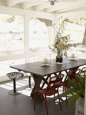 Mix and Match Seating:     Dining chairs don't have to be part of a matching set. To accompany the table of this Napa Valley screened porch, designer Ken Fulk pulled up chairs salvaged from a French park and tractor-seat stools. Chairs through Chelsea Antiques.