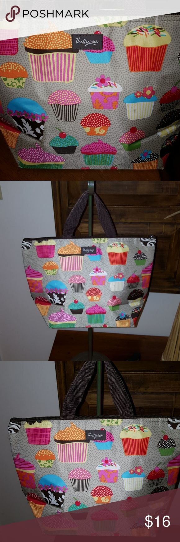 Cupcake lunch bag by thirty-one Adorable cupcake print, brown handles, zipper on top, excellent condition. Bundle and save. thirty-one Bags