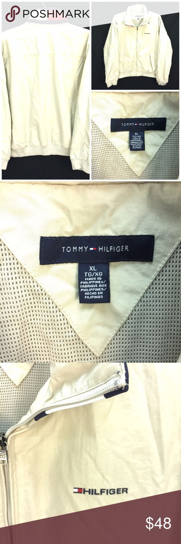 "Tommy Hilfiger Yacht Windbreaker Sz XL Tan Hooded *  Tommy Hilfiger full zip sailing/yacht windbreaker/jacket; size XL  *Features mesh lining; logo on chest; TH flag logo wraps around collar; which holds concealed hood  * Please see below for measurements; all measurements taken with garment lying flat.  Please see all photos for complete condition assessment.  Shoulder to Shoulder: 22"" Armpit to Armpit : 27"" Waist: 24"" Overall Length: 25"" Sleeve: 27"" Item Number: 2704 R Tommy Hilfiger…"